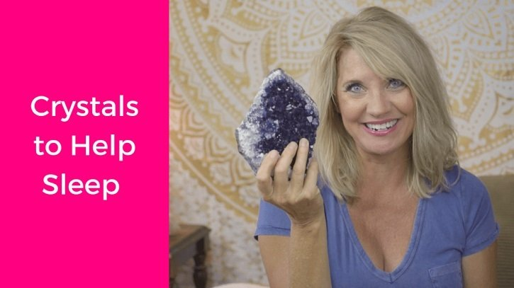 Trish McKinnley holding up purple crystal with 'Crystals to Help Sleep' written beside her