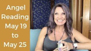 Trish McKinnley smiling with 'Angel Reading May 19 to May 25' beside her