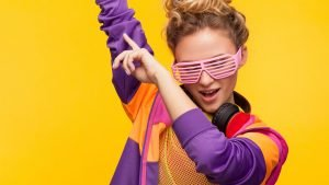 a woman with sunglasses and headphones dancing