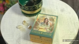 Akaschic Tarot Deck, citrine and green and gold singing bowl.