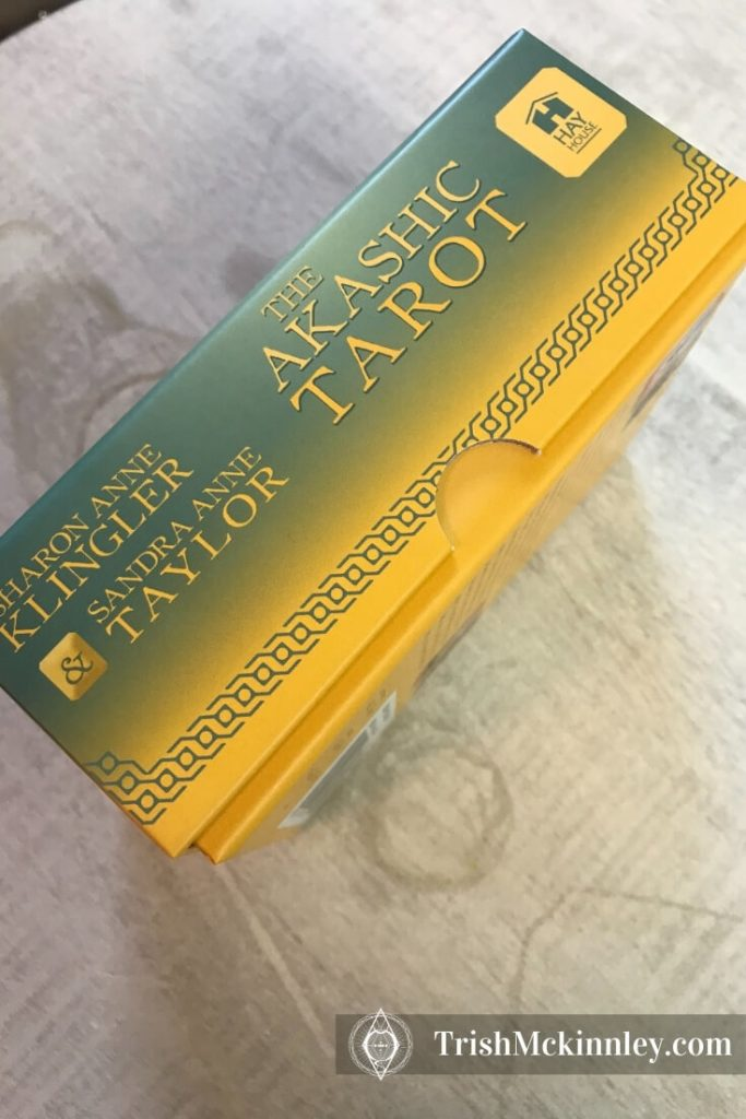 Akashic tarot deck side view to show notches in box.