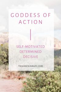 """""""Goddess of Action - self-motivated, determined, decisive"""" text over a mountain landscape in background."""