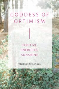 """Goddess of Optimism- positive, energetic, sunshine"" text over nature background of woods with sunshine streaming through"