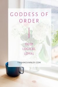 "Goddess of Order- Deep, Logical, Loyal"" text over flowers in vase and blue coffee mug in background."