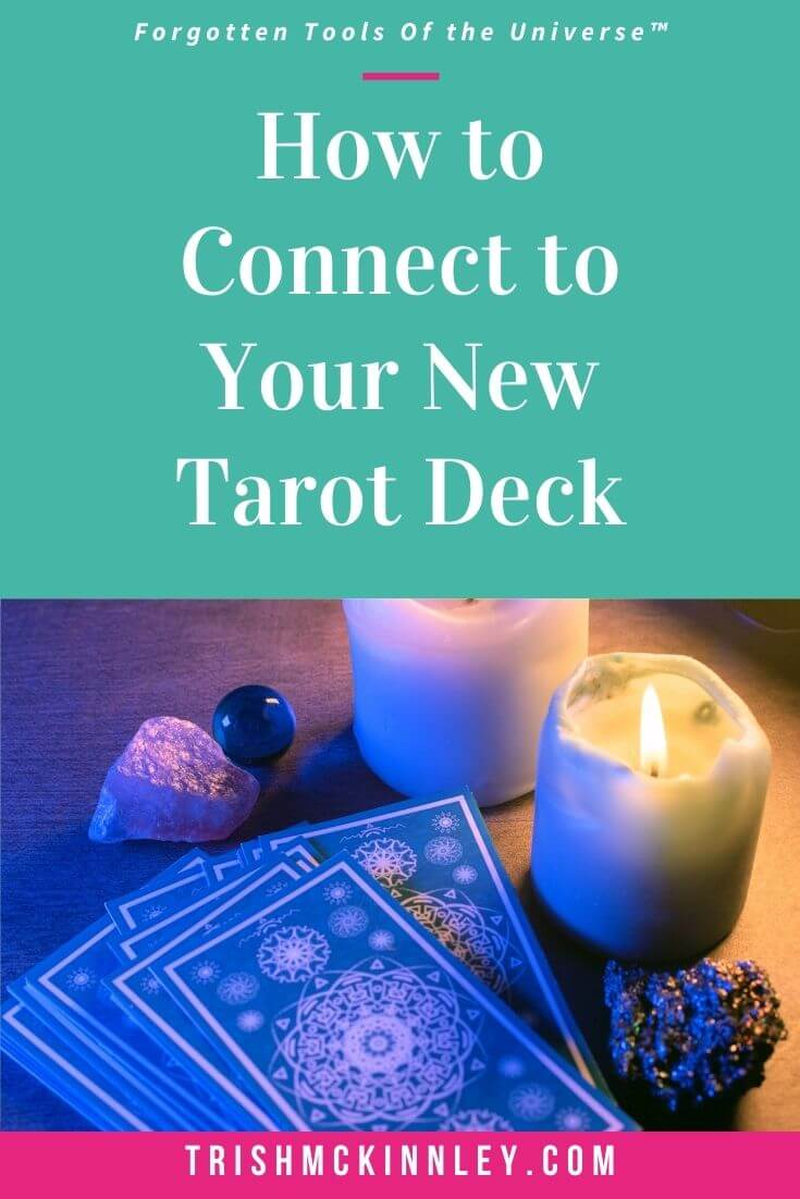 Connect to your tarot deck - pinterest image with a deck of tarot cards, candles and crystals.